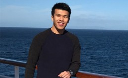 Front-end developer and Web designer, Maurice, standing near a rail on a cruise ship in the coast of the beautiful California.