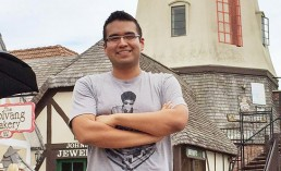 Front-end Developer, Walter, standing in front of a windmill looking like a badass in Solvang.